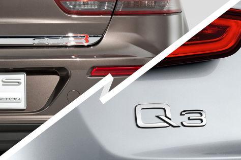 Schriftzug Qoros Limousine und Audi Q3
