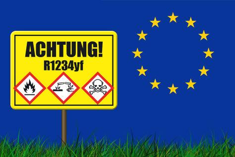 Kältemittel-Warnschild vor EU-Emblem