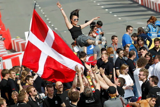 The team of The DTU Dynamo, vehicle No. 501, UrbanConcept, running on Ethanol E100 (100% Ethanol), competing for team Technical University of Denmark from Technical University of Denmark, Denmark celebrates during the Awards Ceremony at the Shell Eco-marathon Europe at The Ahoy centre in Rotterdam, The Netherlands on Sunday, May 19, 2013. (Bas Czerwinski/AP Images for Shell)