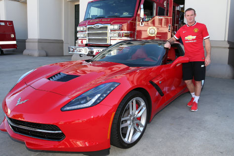 Wayne Rooney mit einer Corvette