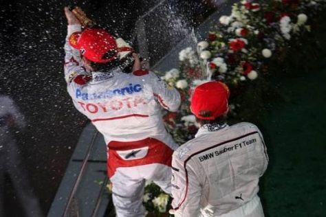 Nick Heidfeld und Timo Glock bei der Siegerehrung