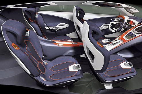 Frei schwebende Einzel-Schalensitze mit integrierten Sicherheitsgurten.