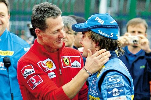 Rekordweltmeister gratuliert Doppel-Weltmeister: 2005 und 2006 holte Fernando Alonso den Titel.