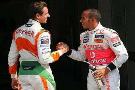 Adrian Sutil und Lewis Hamilton gratulieren sich zur Startreihe eins
