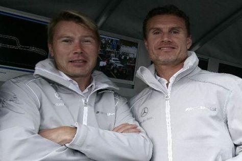 Mik Häkkinen und David Coulthard drücken Gary Pafffett beim Finale die Daumen
