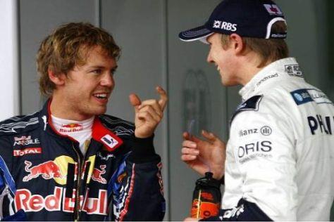 Sebastian Vettel fachsimpelt mit dem Polesetter Nico Hülkenberg