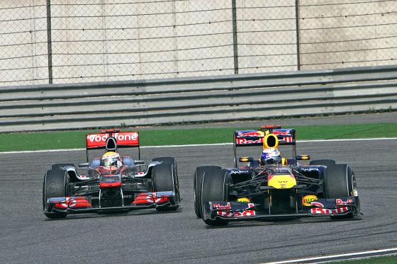 Lewis Hamilton (GBR) McLaren Mercedes and Sebastian Vettel (GER) Red Bull Racing