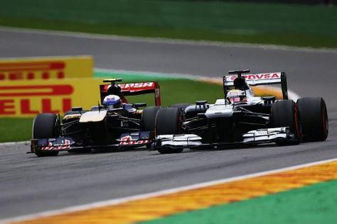 Von Startplatz 19 kämpfte sich Ricciardo (links) in Belgien beherzt nach vorne