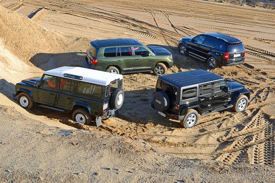 Vier klassische Geländewagen