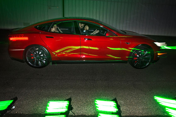 Tesla Model S P85D - People speed by as they take a test drive of Tesla ''D'' an all-wheel-drive at the municipal airport in Hawthorne on Thursday