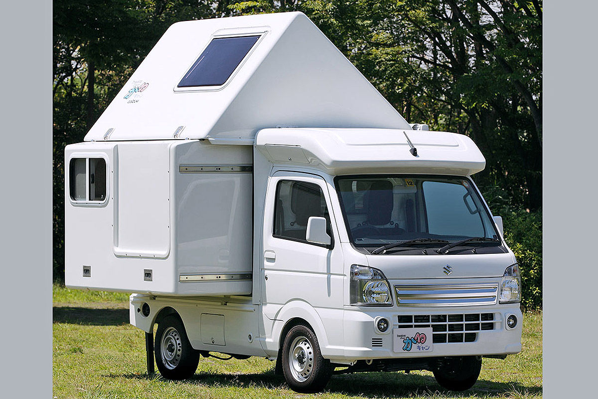 The different bed types of a Kei truck can be customized as is the case with this Kei Camper. White Kei camper with foldouts and a custom hardtop.