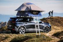 Camping auf dem Autodach