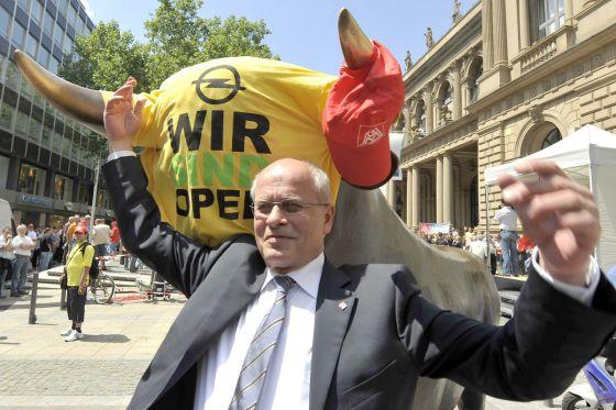 IG-Metall-Chef Berthold Huber forderte Kanzlerin Angela Merkel auf, nach den Zugeständnissen der Opel-Belegschaft ihrerseits die Abmachungen zu erfüllen.